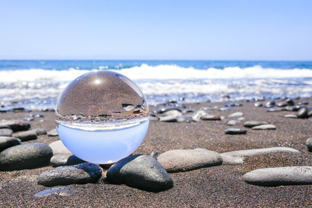 Photo for Crystal ball on stonyt beach in Madeira Portugal - Royalty Free Image