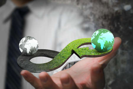 Photo pour Green circular economy concept. Hand showing arrow infinity symbol with grass texture and two globes of different colors. - image libre de droit