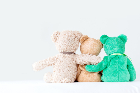 Photo pour Friendship -three teddy bears holding in one's arms - image libre de droit
