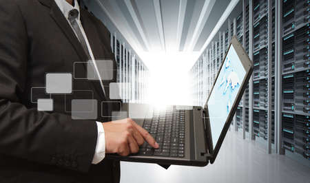 Foto de business man use notebook in server room - Imagen libre de derechos