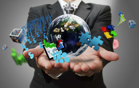 business man hand shows the world of business as conceptElements of this image furnished by NASA