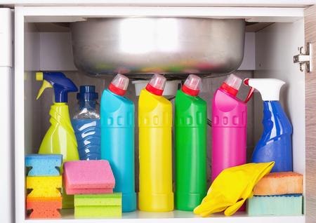 Foto de Cleaning products placed in kitchen cabinet under sink. Housekeeping storage space - Imagen libre de derechos