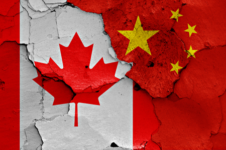 Photo pour flags of Canada and China painted on cracked wall - image libre de droit