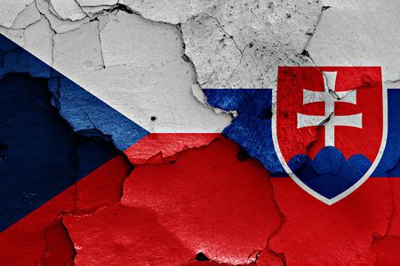 Foto de flags of Czech Republic and Slovakia painted on cracked wall - Imagen libre de derechos