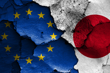 Photo for flags of European union and Japan painted on cracked wall - Royalty Free Image