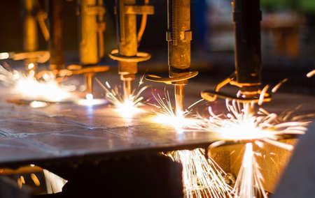 Foto de CNC LPG cutting with sparks close up  - Imagen libre de derechos