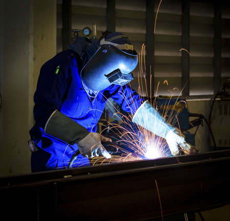 Photo for worker with protective mask welding metal  - Royalty Free Image