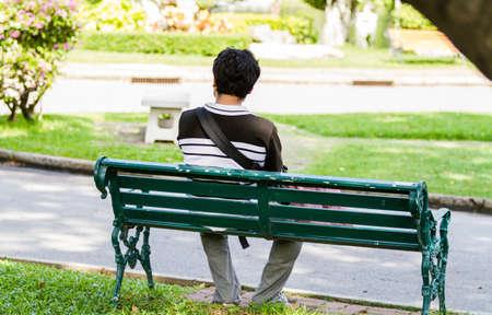 Foto de Man sitting alone on park - Imagen libre de derechos