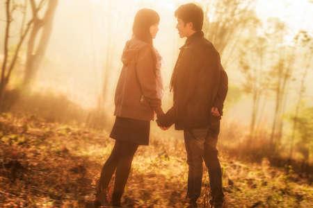 Photo pour Attractive asian couple spending time together in the park - image libre de droit