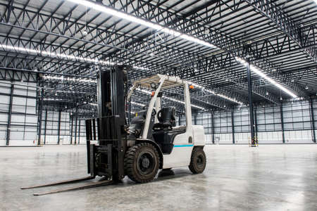 Photo for Forklift loader in large modern storehouse - Royalty Free Image