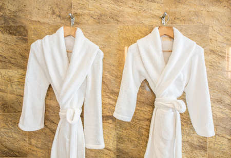 Photo for White bathrobe on hanger - Royalty Free Image