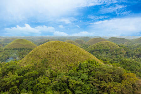 Photo pour Chocolate Hills with blue sky in the green season, Bohol, Philippines - image libre de droit