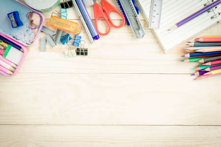 Foto de School and office supplies on wood background. Back to school. - Imagen libre de derechos