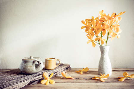 Photo for Teapot and flower, home decoration concept - Royalty Free Image