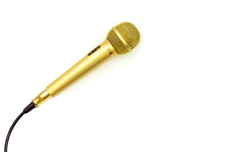 Foto de Microphone Gold on isolated white.  Entertainment and sound concept - Imagen libre de derechos