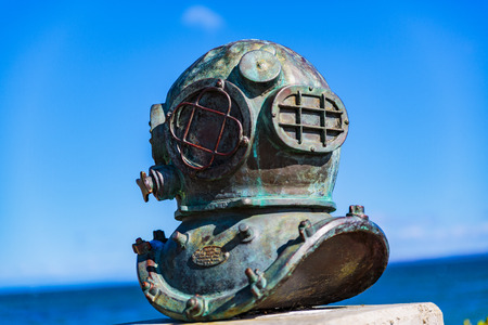 Photo for Monterey, California - USA;  February 19, 2018:  A bronze memorial sculpture to ten hardhat divers who once serviced the sardine industry. The divers worked on installing and repairing underwater pipes that transported the fish from floating pens to the c - Royalty Free Image