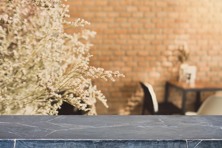 Foto de Stone table top and blurred bokeh cafe and coffee shop interior background with vintage filter - can used for display or montage your products. - Imagen libre de derechos