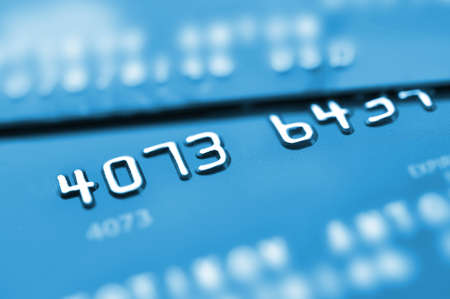 Credit cards in blue tone with shallow depth of field