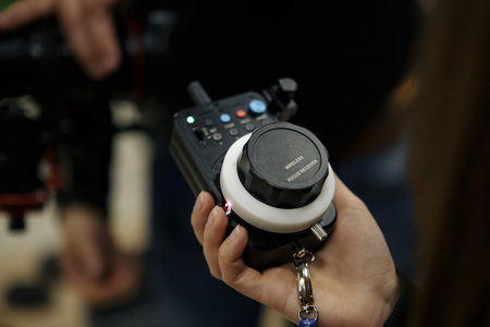 Photo for Male hands hold the wireless follow focus system during the filming process. - Royalty Free Image