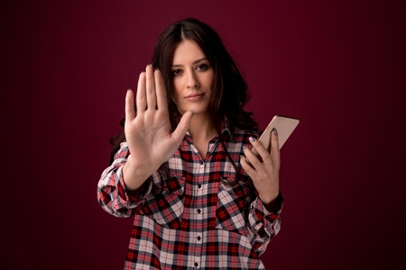 Photo pour girl or young woman holding mobile phone as internet stalked victim abused in cyberbullying or cyber bullying stress concept and in smartphone and network addiction - image libre de droit