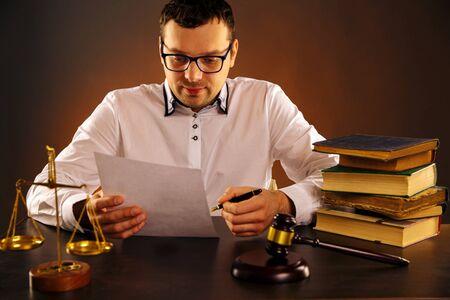 Foto de Young man judge on his table working with paper documents. - Imagen libre de derechos