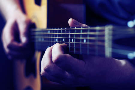 Photo for Hands playing acoustic guitar, close up - Royalty Free Image