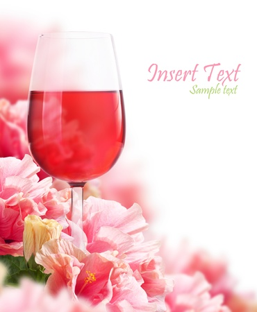 The beautiful backdrop of flowers hibiscus and a glass of wine