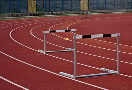 athletic stadium and several hurdles in athletic lines