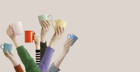 Photo pour Many different arms raised up holding coffee cup - image libre de droit