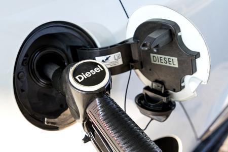 Photo pour car refueling diesel pump at petrol station - image libre de droit