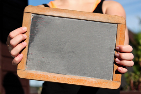 Photo for blank slate shown by young female - Royalty Free Image
