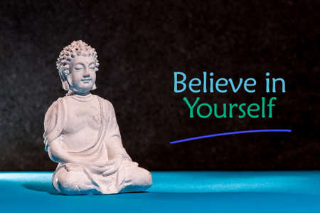 Photo for Believe in Yourself. Inspirational and motivating phrase near little buddha figurine - Royalty Free Image