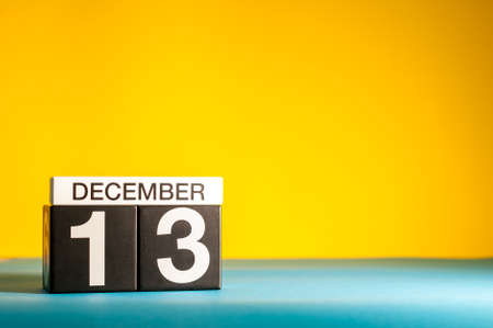 Photo pour December 13th. Image 13 day of december month, calendar on yellow background with empty space for text - image libre de droit