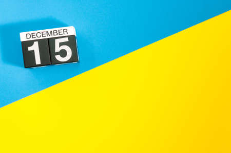 Photo pour December 15th. Image 15 day of december month, calendar on blue-yellow background with empty space for text, mockup - image libre de droit