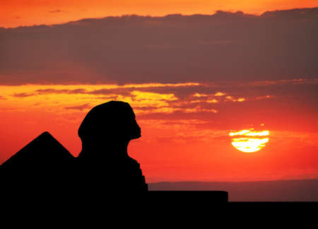 Photo for Sphinx  and Pyramids silhouette at orange sunset sky in Egypt - Royalty Free Image