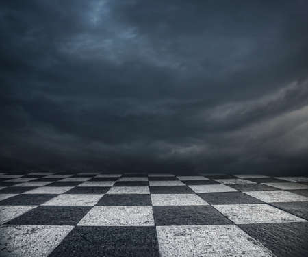 Photo pour Chess floor and dramatic overcast sky premade background - image libre de droit