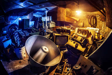 Photo pour Megaphone and old grunge electronical stuff in Basement in blue and yellow colors - image libre de droit