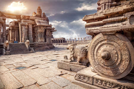Photo for Stone chariot in courtyard of Vittala Temple at sunset overcast sky in Hampi, Karnataka, India - Royalty Free Image