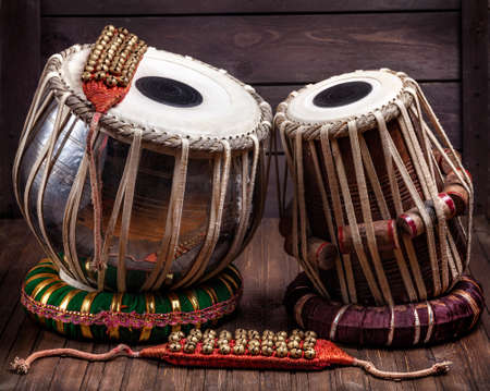 Photo for Tabla drums and bells for Indian dancing on wooden background - Royalty Free Image
