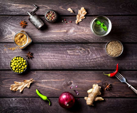 Foto per Spices and ingredients for the dish on the wooden background with space for text - Immagine Royalty Free