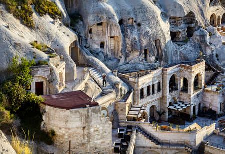 Photo for Hotel boutique in the Tufa Mountains at sunset in Goreme city, Cappadocia, Turkey - Royalty Free Image