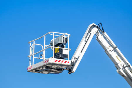 Photo for Bucket truck high up of a crane with blue sky - Royalty Free Image