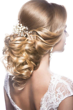 Photo pour Portrait of a beautiful  woman in image of the bride. Picture taken in the studio on a black background. Beauty hair. Hairstyle back view - image libre de droit