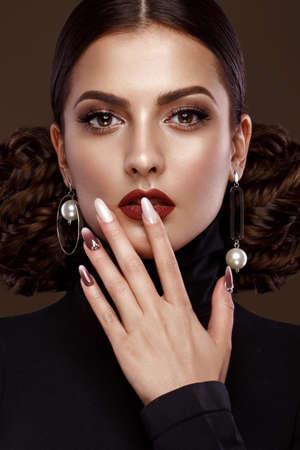 Foto de Pretty girl with unusual hairstyle, bright makeup, red lips and manicure design. Beauty face. Art nails. Studio portrait - Imagen libre de derechos