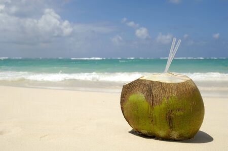 A Coconut drink on exotic beach at the Dominican Republic