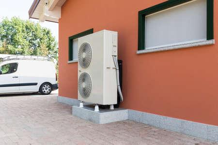 Foto de heat pump air - water for heating a residential home - Imagen libre de derechos