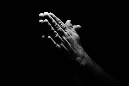 Photo pour Praying Hands in black background - image libre de droit