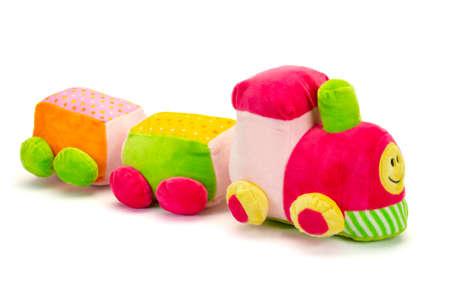 Foto de Colorful stuffed train with shadow sitting on white background. - Imagen libre de derechos