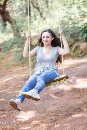 Foto de happy young woman on the swing of the tree in Mazamitla, Mexico - Imagen libre de derechos