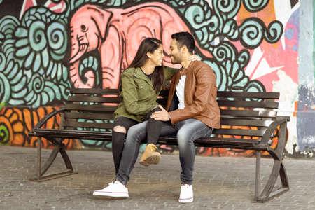 Foto de Couple in love. Enjoying happy in public park - Imagen libre de derechos